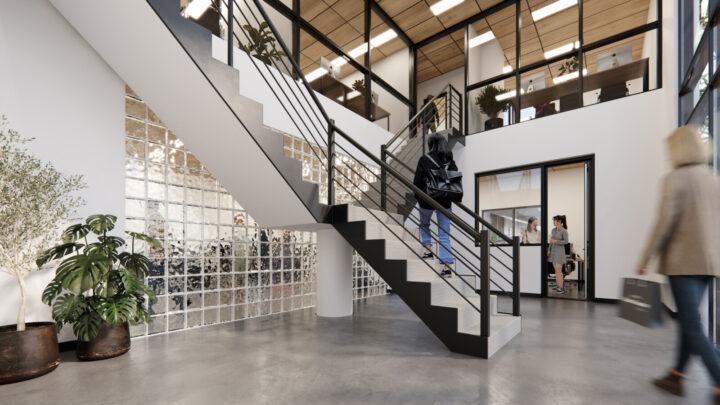 Members walking up stairs in office corridor.